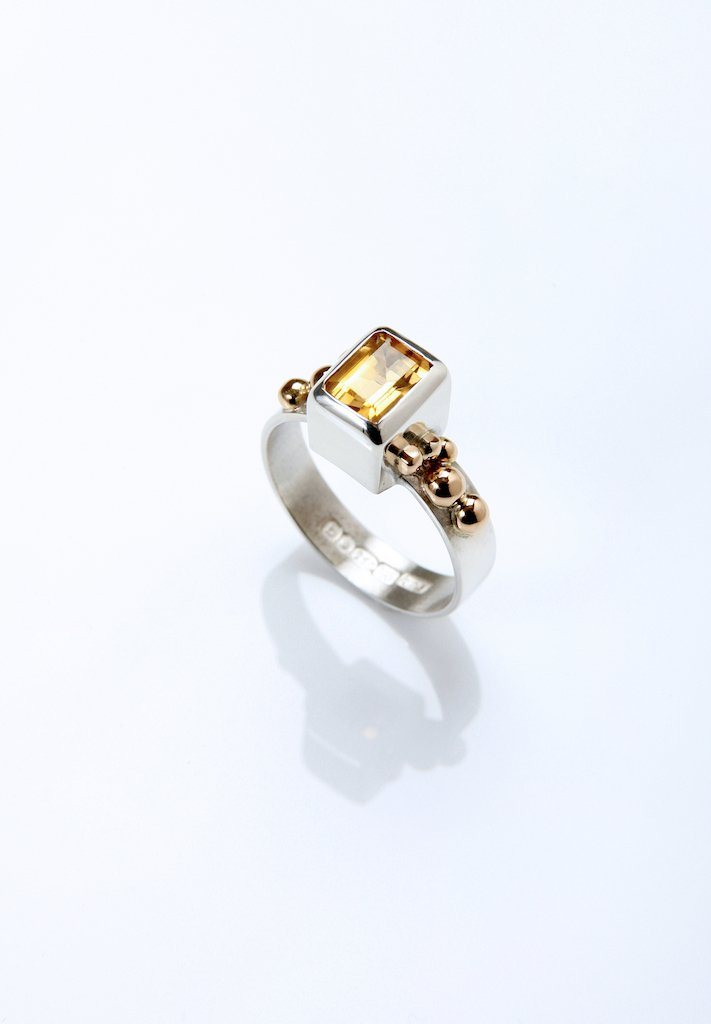 High set citrine in silver and gold ring