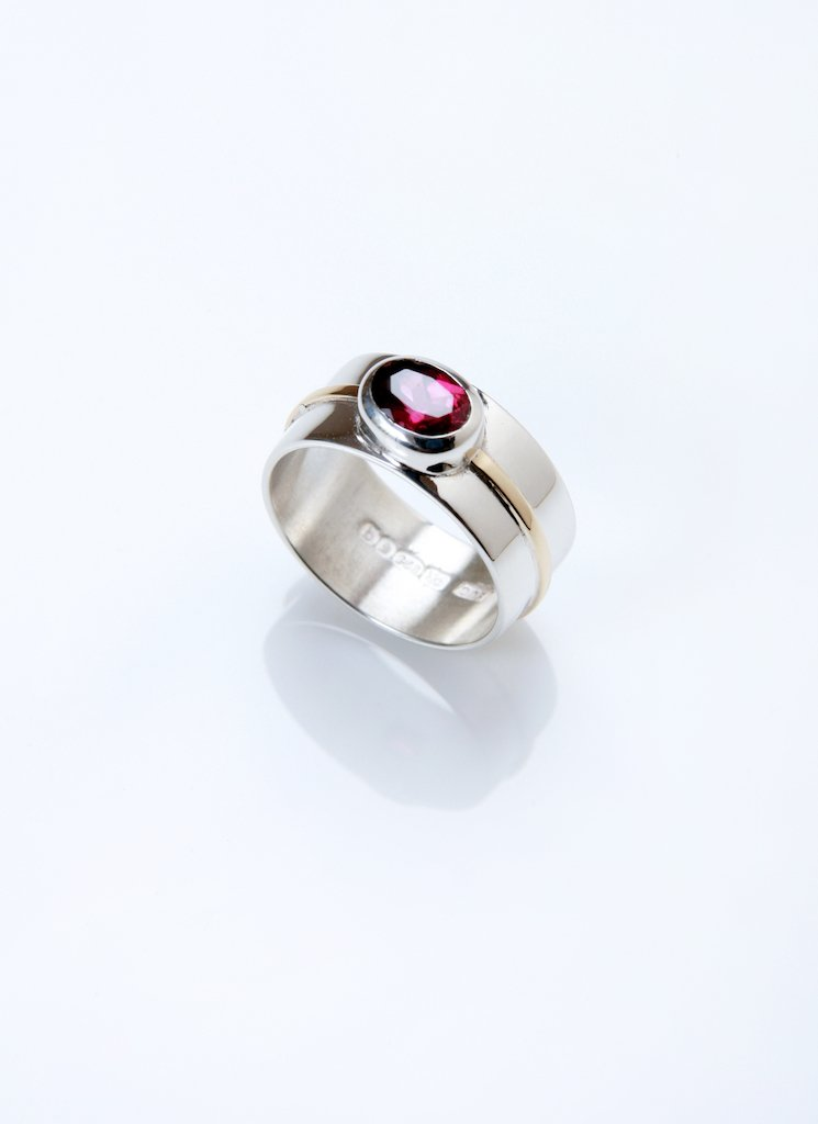 Rich pink garnet, silver and gold ring by Emma Jane Champley.